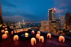 Take in the city from the world's highest bar, an outdoor terrace, a traditional junk, and more spectacular spaces