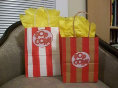 I painted stripes on plain gift bags, printed out the popcorn image and found some fun tissue paper that had scalloped edges.  I filled the bag with candy, a soda and a gift certificate for the movie theater.