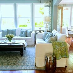 Another view of open floor plan living room. I love the windows... beautiful light House of Turquoise: Wicks Nest