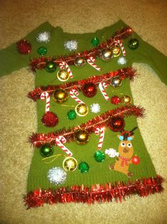 22 Fun and Quirky Christmas Costume Ideas For Your Holiday Party ugly christmas sweater, ugly christmas sweater diy, ugly christmas sweater party ideas, ugly christmas sweater mens ugly christmas sweater party, ugly christmas sweater ideas. Ugly Sweater Day, Diy Ugly Christmas Sweater, Xmas Sweaters, Green Sweater, Tacky Christmas Party, Christmas Costumes, Christmas Ideas, Tacky Christmas Outfit, Christmas Clothes