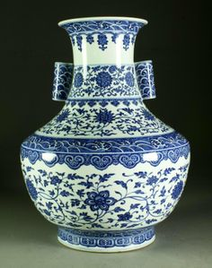 """A Fine & Large Chinese Blue & White Porcelain Vase Of archaic form having two tubular handles, the whole finely painted to depict lotus blossoms, tendrils and crashing waves, having a seal mark in underglaze blue, very large measuring 21""""H x 16.5""""Dia."""