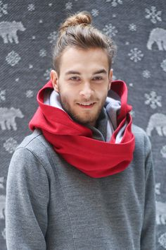 A scarf/hood is a perfect fit for those who don't put caps on not to spoil their haircut. You can easily wear it all day, then put it off and still look nice. Additionally, it can be worn as a scarf. Sweater material on the outside, tracksuit fabric on the inside.