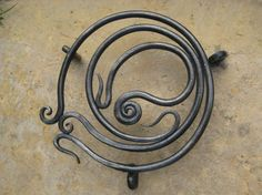 $40 wrought iron trivet