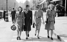 An official Ministry of Information Photo Division wartime photograph showing four fashionable young ladies enjoying a stroll in the spring sunshine