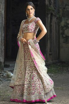 Dupion silk ghagra with all over cutwork jal embellished with stone sequins and zari work along with net dupatta.