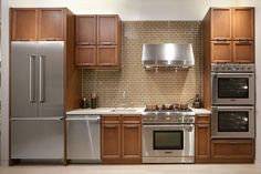 A neutral tile such as this will surely make a range hood pop!