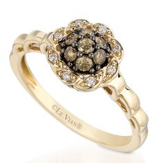 Banded by interweaving rows of luscious Chocolate Diamonds, this stylish ring features elegant accent of Vanilla Diamonds to create a red carpet worthy design exclusive to Le Vian. Description from jewelrywarehouse.com. I searched for this on bing.com/images