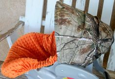 Realtree hood cover with orange minky car seat by SqueakyBugBabies