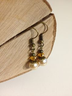 Beautiful handmade vintage inspired pearl drop earrings with amber coloured crystals Antique bronze finish. They will be presented on our bespoke card & wrapped in tissue paper. Amber Earrings, Pearl Drop Earrings, Amber Color, Vintage Inspired, Gifts For Her, Jewelry Accessories, Pearls, Crystals, Bronze Finish