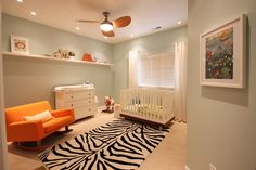 love this wall color, can lights and modern fan for the boys shared room