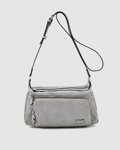 e938550ba0 Bandolera mediana de mujer en gris con bolsillos exteriores