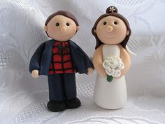 Mini Bride and Groom wedding cake toppers made of Fimo, Spiderman fan and his bride.