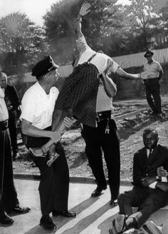 Civil rights activist Elizabeth Victoria Spencer being grabbed by the police during a segregation protest in 1963.