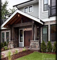 Like the nice dark paints with white and black trims. Also love the stone columns it makes it eye appealing.