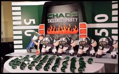 For a tailgate themed Bar Mitzvah, football helmets were used as place cards to tackle the seating assignments from Dazzling Parties.