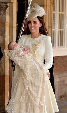 Duchess of Cambridge again turned to her unofficial royal ceremonial designer of choice Sarah Burton of Alexander McQueen for her dress. The new mom looked fabulous in an ivory Alexander McQueen spring 2012 knee length ruffle dress. It features a padded shoulder and a t-shape ruffle detail from the neck down.  Kate Styled her look with a matching ivory Jane Taylor fascinator, and her trusted nude LK Bennett pumps. HRH Prince George of Cambridge Christening Ceremony, October 23, 2013