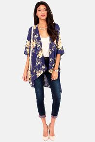 """Let it be known that your spirit is free yet sophisticated with The Peacenik Blue Floral Print Kimono Jacket! This square-cut kimono top features an exquisite floral print in shades of yellow, pink, red, and brown blooming across a deep blue fabric, giving it a Bohemian yet modern feel. An oversized bodice is great for layering, while wide, three-quarter sleeves flow into a draping open front. Unlined. Model is 5'10"""" and is wearing a size small. Top measures 4.5"""" longer at back. 100%…"""