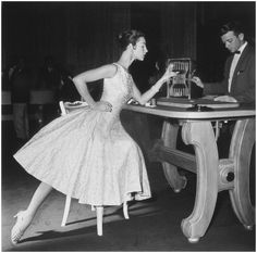 A fashion photo that Roger Prigent took in a casino in the Dominican Republic, from Vogue magazine in the mid-1950s