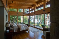 Bringing the outdoor in!  Luxurious and rustic master bedroom retreat.