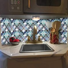 """This Arabesque Peel and Stick Backsplash Can Renovate Your Kitchen, which Can Be Applied to Rv, kitchen and Bathroom. the size of the tile is 11""""x10"""", which covers 10% more area than 10""""x10"""" tile covers. High quality assurance. Easy to install, just peel and stick(not real tile and not just sticker).More blue color than green. Peel N Stick Backsplash, Peel And Stick Tile, Stick On Tiles, Mosaic Tile Stickers, Arabesque Tile, Decorative Wall Tiles, Smart Tiles, Tile Covers, Kitchen Wallpaper"""