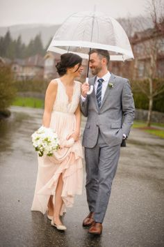 Westwood Plateau Wedding bride and groom walking in the rain. Stunning pink lace wedding dress – Allison and Scott | Vancouver Wedding Photographer – Hayley Rae