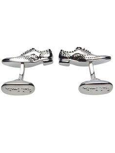 Shoe cuff links in black from Paul Smith. This pair of pewter and brass cufflinks features a an oxford shoe with yellow enamel insole. Measures 1