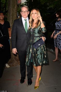 Co-ordinated couple: Matthew was suited and booted in a dapper black two-piece, which he t...