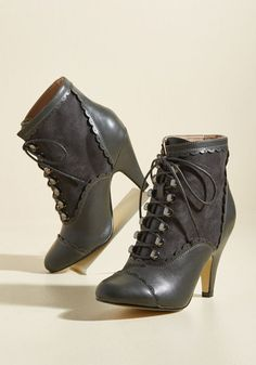 If you were make one wish, it would be for the exact style accomplishment that these vintage-inspired boots achieve! This dark grey pair is detailed with scalloped trim, silver shoe lace hooks, and a combo of faux leather and imitation suede that stand atop tapered heels with nobility.