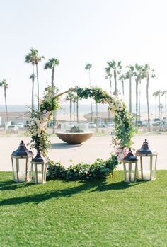 Circular Ceremony Arch Does Double Duty At Reception ~ gorgeous circle backdrop with lanterns by The Flower Method