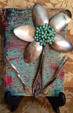 Spoon art ,made with paper, jewelry, and wood.