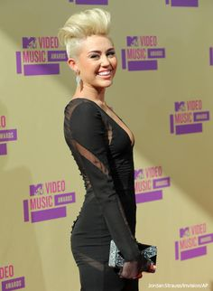 Miley Cyrus stepped out with her new haircut at last night's MTV VMA