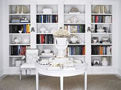 The white shelves share space with books and china pieces.  It's a nice look that doesn't look too cluttered.  http://www.rd.com/home/how-to-stylishly-organize-your-bookshelves/