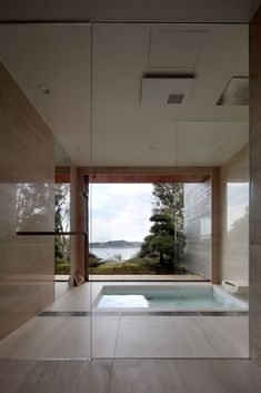Image 8 of 50 from gallery of House / CUBO design architect. Photograph by Koichi Torimura Ground Floor Plan, Bath Design, Architect Design, Pool Designs, House, Home Remedies, Photo Wall, Floor Plans, Windows