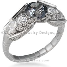 Dragonfly Engagement Ring - Fly, fly, dragonfly! In this nature-inspired engagement ring, two winged beauties hold the center stone together with their wingtips. Note the intricate detail and exquisite craftsmanship in their sets of wings! To accommodate larger stones, the wings can spread out. Their bodies are adorned with flush-set, marquise-shaped diamonds or gemstones. Their eyes twinkle with 2mm round stones, and their elongated bodies meet in the ribbed band.