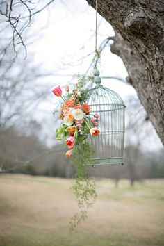 Bird Cage - For a vintage style wedding, fasten fresh flowers to an antique #birdcage. {Paperlily Photography}
