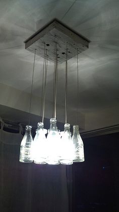 A light fixture made Magnolia Choco Vim bottles - a drink which I used to love when I was a kid Champagne Flutes, Magnolia, Light Fixtures, Bottles, Chandelier, Kid, Ceiling Lights, Lighting, Drinks
