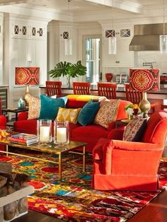 Eclectic Living Room with Gilded classic coffee table, Crown molding, Nuloom pop nina red & blue area rug, Hardwood floors