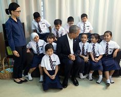 President Obama talks with refugee children at the Dignity for Children Foundation.