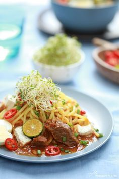 Mee Rebus: Malaysia, Indonesia & Singapore dish of egg noodles with a sweet curry sauce made from sweet potato.
