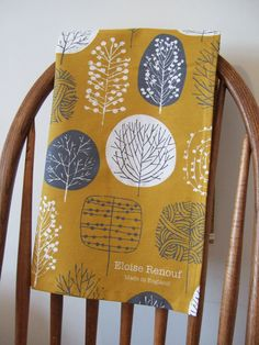 Trees Tea Towel in mustard and charcoal from English designer Eloise Renouf. $17.00, via her shop on Etsy.