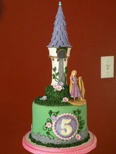 """Tangled"" themed cake and cupcakes for a birthday cupcake tower. Figures supplied by the customer."