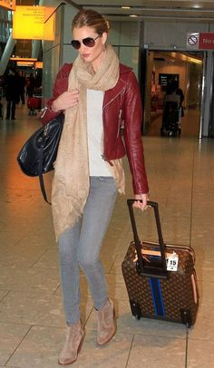 Rosie Huntington-Whiteley wears a red leather jacket as she arrives at Heathrow International Airport from Los Angeles.