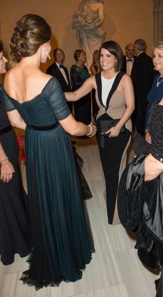 Catherine, Duchess of Cambridge, aka Kate Middleton, and Princess Eugenie attend a gala dinner in support of the University of Saint Andrews 600th Anniversary at the Metropolitan Museum of Art, NYC. Kate is re-wearing a Jenny Packham gown, her Jimmy Choo Cosmic heels, and a diamond and emerald demi-parure (the earrings and bracelet are a private gift). 12/09/14