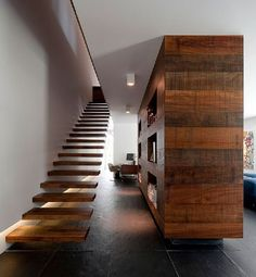Floating Wooden Staircase at Contemporary Green House Design in Estoril by Frederico Valsassina Arquitectos