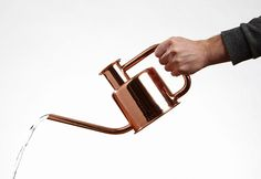 the 'X3 watering can' by paul loebach is made from a single metal tube, bent three times to create both the handle and the pour spout.