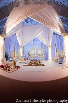 White Indian wedding mandap on IndianWeddingSite.com