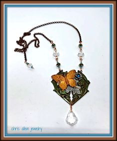 Gingerbread Butterfly assemblage necklace with silver leaves and flower on a brown and green heart base with matching Swarovski crystals. Lilac Bushes, Mixed Metals, Chocolate Brown, Jewelry Crafts, Gingerbread, Swarovski Crystals, Jewelery, Crafting, Butterfly