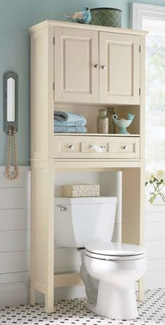 Affordable Bathroom Storage Ideas  turn the clutter of the #bathroom into an example of stylish organization with these bathroom #storage ideas. A cabinet offers extra space for storing toiletries. Towels are at the ready for bath time when rolled and stuffed into an open basket or storage bin. Claim the space over your toilet by adding a bathroom space saver above the toilet to make use of vertical space. Use apothecary jars for cotton balls, swabs and bath salts.