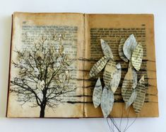 untitled story. altered book by Ines Seidel Munich based artist, she uses books as the background in a landscape. Crisscrossing the landscape with string, Seidel embeds rocks, fastens folded packets of paper, and stitches independently cut words into the book.
