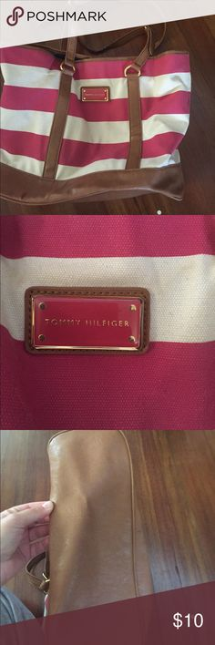 TOMMY HILfIGER-tote Lightly used but still in goodcondition. Only wear is on the straps (last pic) price is lowered for that reason Tommy Hilfiger Bags Totes